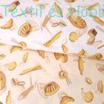 Kenyeres, pékárus pamutvászon sárgás alapon