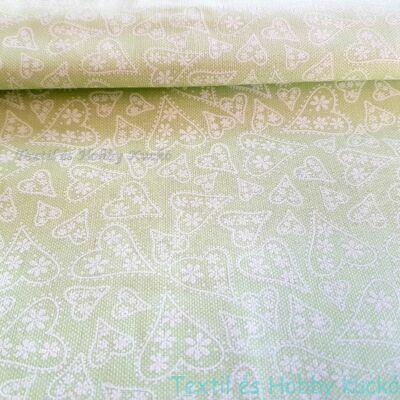 Fehér szívecskés pamutvászon halványzöld alapon