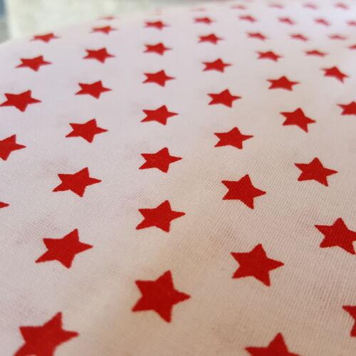 Piros csillagos pamutvászon fehér alapon