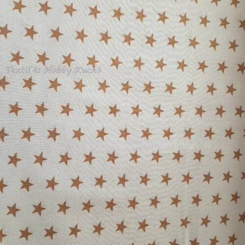 Arany/drapp csillagos pamutvászon fehér alapon