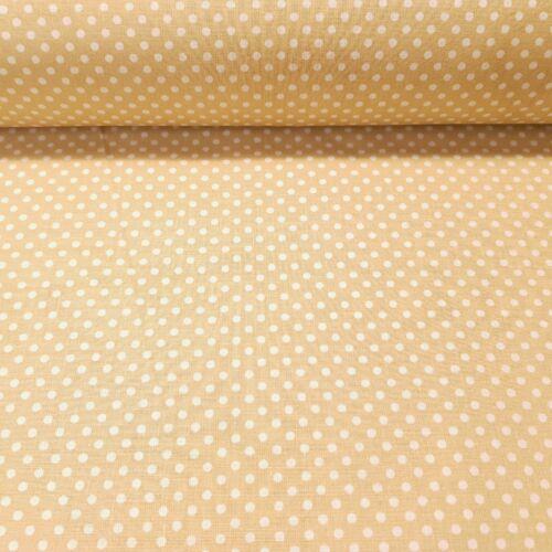 Bézs alapon pöttyös pamutvászon ( 2 mm )